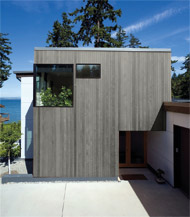 Une maison recouverte du revêtement BLU HOUSS © Juste du Pin