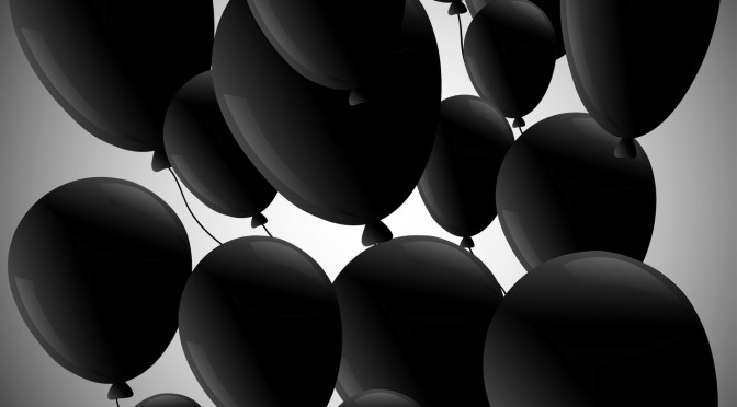 Black balloons  on grey background