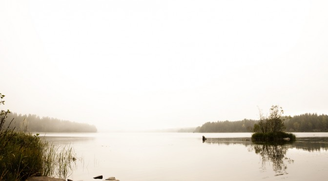 A quiet calm lake with fog